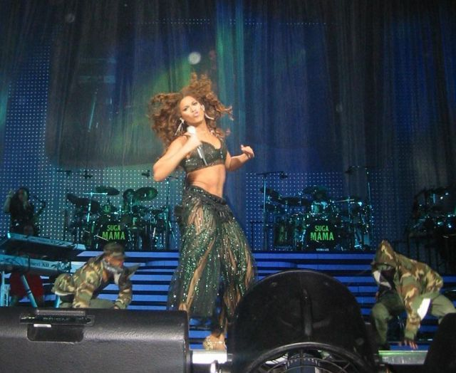 Beyonce performing live in concert.