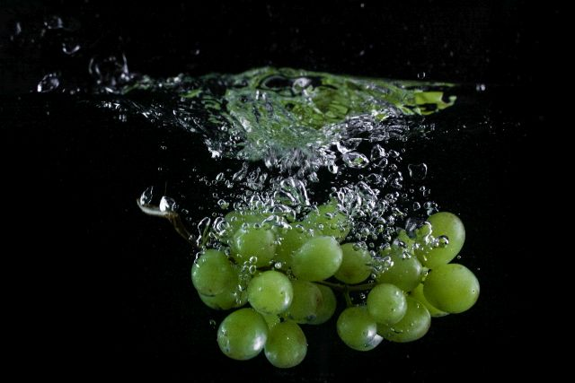 Grapes dropped in water.