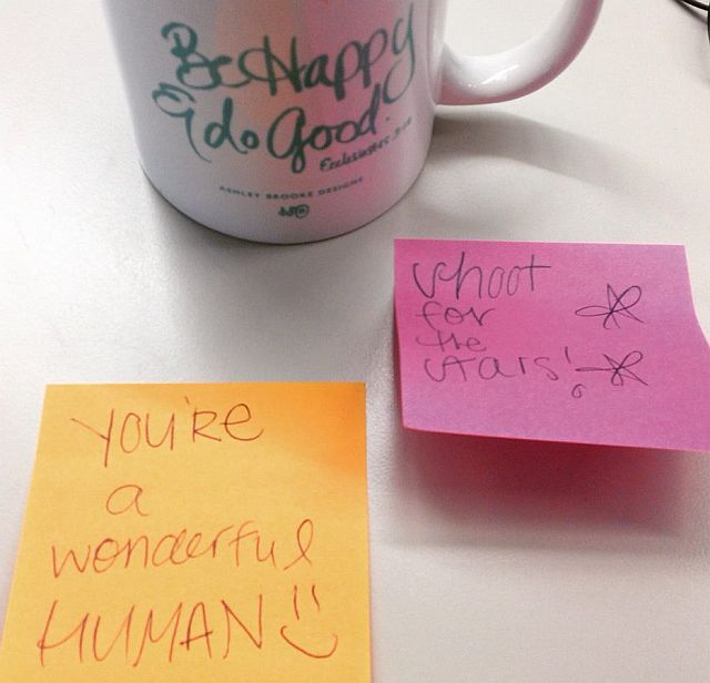 Picture of mug and post-its with inspirational quotes
