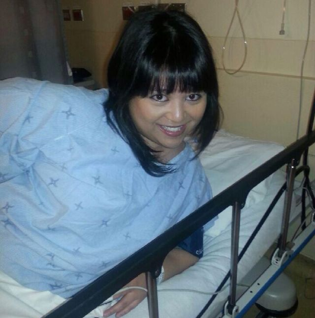 Me in a hospital bed waiting for my liver biopsy.