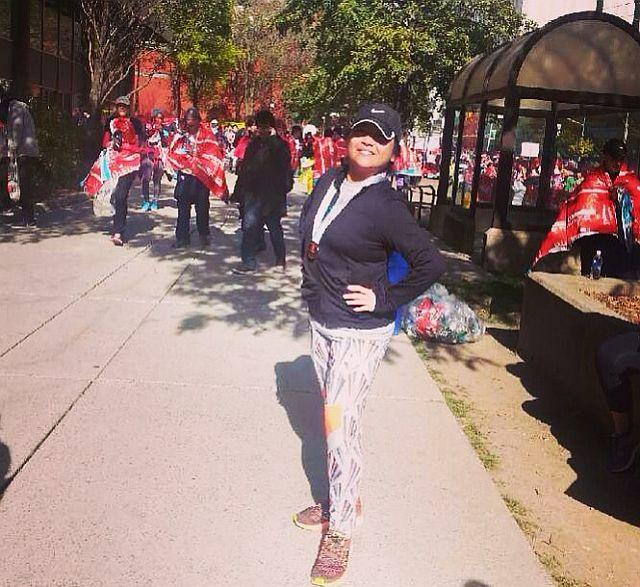 Posing after finishing the Scotibank Half Marathon, Toronto, Canada