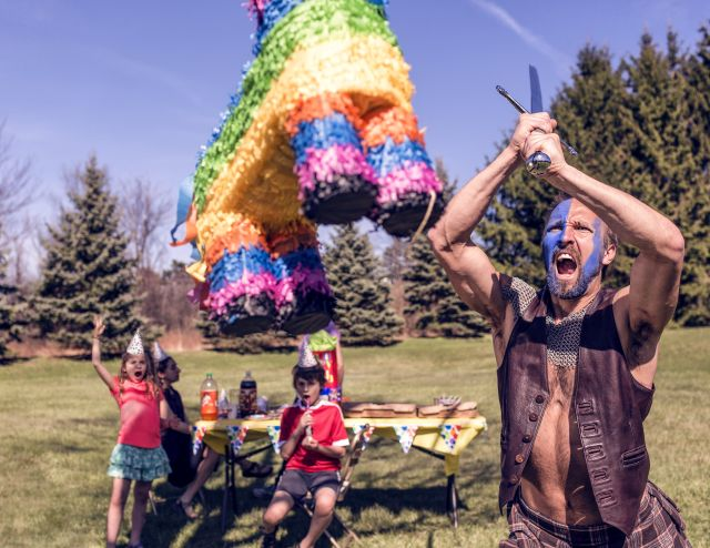 Intense man hitting a pinata for his kids