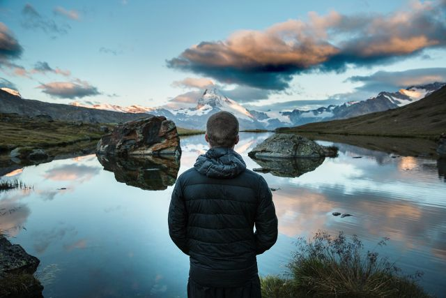 Man staring out onto lake - overcome fear and anxiety