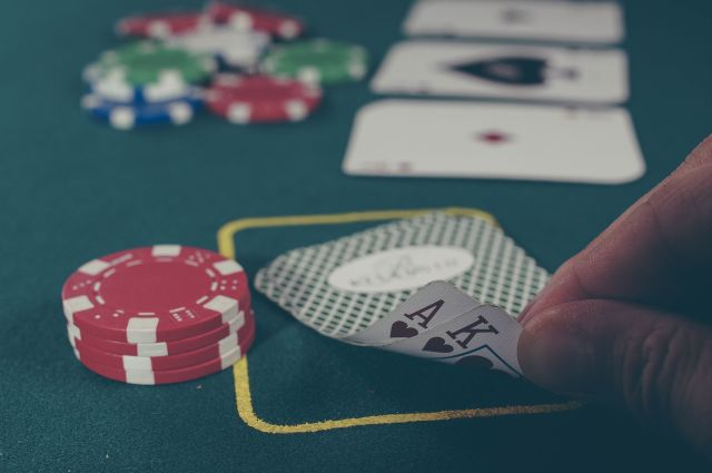 Picture of poker chips and cards - raising the stakes